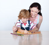 Mother and son doing homework together — Stock Photo