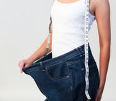 Close-up of woman wearing big jeans focus on woman — Stock Photo