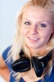 Beautiful woman with headphones on — Stock Photo