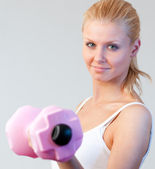 Close-up of a beautiful woman trained with weights focus on woman — Stock Photo