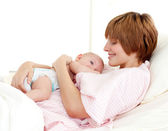Patient and newborn baby in bed — Stock Photo