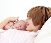 Beautiful patient with newborn baby in bed — Stock Photo