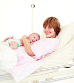 Mother holding her newborn baby — Stock Photo
