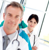 Female doctor in a row — Stock Photo
