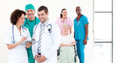 Group of smiling doctors looking at the camera — Stock Photo