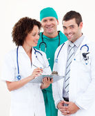 Team of relaxed doctors looking at the camera — Stock Photo