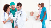 Doctors examining a patient at the hospital — Stock Photo