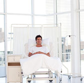Smiling patient recovering in a hospital — Stock Photo