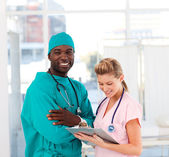 Surgeon and nurse in hospital — Stock Photo