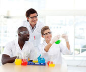 Scientists examining a test-tube — Stock Photo
