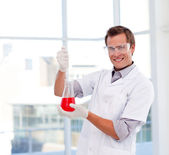Science student examinig a test-tube — Stock Photo
