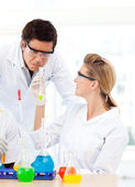 Scientists studying test-tubes — Stock Photo