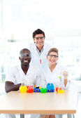 Science students examining test-tubes in university — Stock Photo