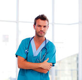 Serious young doctor isolated in hospital — Stock Photo