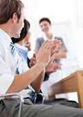 Jolly business applauding a good presentation — Stock Photo