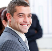 Close-up of a smiling businessman at a presentation — Stock Photo