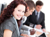 Confident buinesswoman smiling at the camera in a meeting — Stock Photo