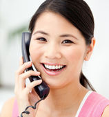 Portrait of a jolly businesswoman talking on phone — Stock Photo