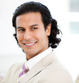 Portrait of a charismatic businessman smiling — Stock Photo