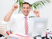 Cheerful businessman punching the air in celebration — Stock Photo