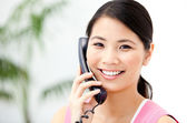 Portrait of a cheerful businesswoman talking on phone — Stock Photo