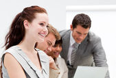Portrait of a smiling businesswoman working with her colleagues — Stock Photo