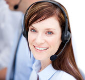 Portrait of caucasian businesswoman with headset on — Stock Photo