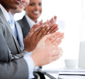 Close up of a mixed business team applauding a presentation — Stock Photo