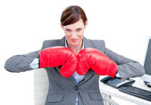 Confident businesswoman preparing to fight with boxing gloves — Stock Photo