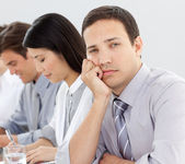 Young businessman bored in a meeting — Stock Photo
