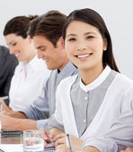 Smiling businesswoman in a meeting with her team — Stock Photo