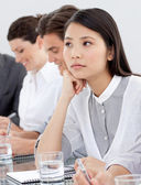 Asian businesswoman bored at a presentation — Stock Photo