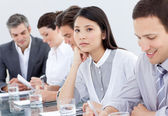 Bored asian businesswoman in a meeting — Stock Photo