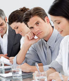 Young businessman bored at a presentation — Stock Photo