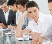 Bored businesswoman at a presentation — Stock Photo