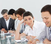 Brunette businesswoman bored in a meeting — Stock Photo