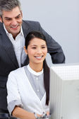 Smiling businesswoman helping by her manager — Stock Photo