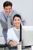Jolly businesswoman helping by her manager — Stock Photo
