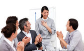 Victorious businesswoman applauded for her presentation — Stock Photo