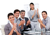 Enthusiastic businessteam applauding after a presentation — Stock Photo