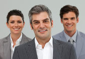 Smiling Business associates standing in a line — Stock Photo