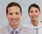 Multi-ethnic business associates in a line — Stock Photo