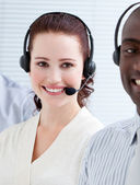 Self-assured customer service representatives standing in a line — Stock Photo