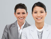 Happy business associates in a row — Stock Photo