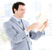 Portrait of a relaxed businessman reading a newspaper — Stock Photo