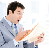Portrait of a exited businessman reading a newspaper — Stock Photo