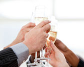 Close-up of businessmen celebrating an event with champagne — Stock Photo