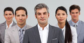 Serious busines standing together — Stock Photo