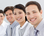 Multi-ethnic business group smiling at the camera — Stockfoto