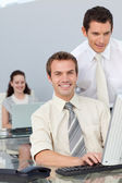 Businessmen working together with a computer — Stock Photo